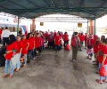 Dideportasi dari Malaysia, 136 TKI Berseragam Merah Baris di Pelabuhan